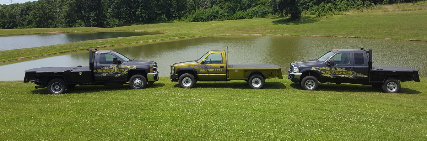Three trucks custom built with Bristow Beds